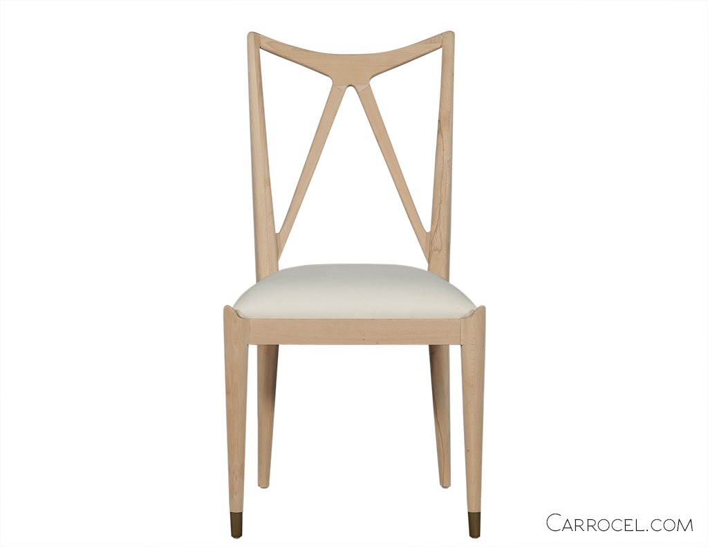 White dining room chair with a W pattern