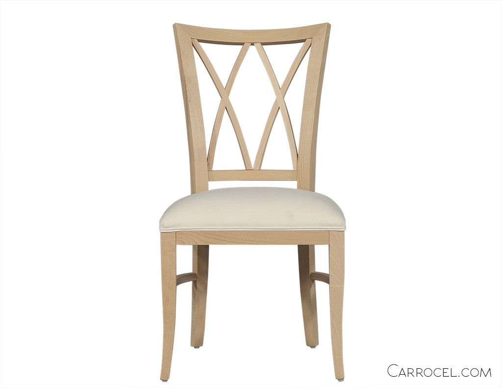 White dining room chair with a X patterns